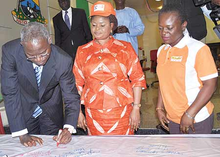 SEX OFFENDERS REGISTER—From left: Gov. Babatunde Fashola of Lagos State, signing to endorse the campaign establishing the Sex Offenders'  Register, yesterday in Lagos, Mrs. Adejoke Orelope-Adefulire, Deputy Governor and Mrs. Itoro Eze-Anaba, Managing Partner, Partnership for Justice (Mirabel Centre), look on.