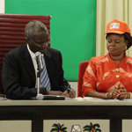 Lagos State Governor, Mr. Babatunde Fashola, SAN (2nd left) signing the Executive Order Establishing a Sex Offenders' Register at the Banquet Hall, Lagos House Ikeja, on Monday, December 1, 2014. With him are: His Deputy, Hon. (Mrs) Adejoke Orelope-Adefulire (2nd right), Attorney-General and Commissioner for Justice,  Mr. Ade Ipaye (left) and the Chairman, House Committee on Works and Infrastructure, Hon. Rotimi Olowo (right).