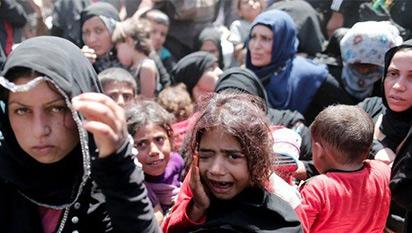 Refugees fleeing Syria and Iraq ; seeking to enter Europe. Credit: BBC